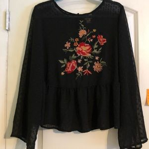 Sheer peplum blouse with embroidered flowers